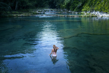 Woman in bikini in river at Semuc Champey, Guatemala