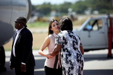 Spain's Queen Letizia Ortiz is greeted by Haiti's first lady Martine Moise during her arrival to Port-au-Prince