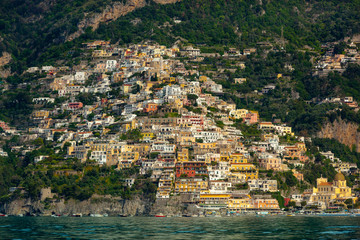 The beautiful Village of Positano at the Italian Amalfi Coast seen from the turquoise Sea on a sunny Morning