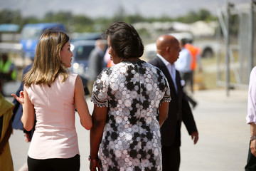 Spain's Queen Letizia Ortiz talks with Haiti's first lady Martine Moise during her arrival to Port-au-Prince