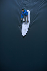 High angle view of man paddleboarding