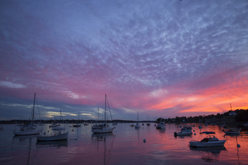Boats in harbor at sunset, York, Maine, USA