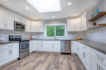 Open concept kitchen equipped with stainless steel appliances.