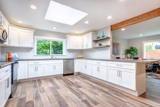 Open concept kitchen equipped with skylight.