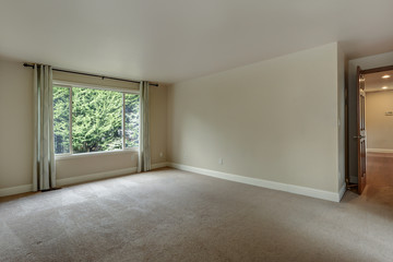 Empty bedroom with carpet floor.