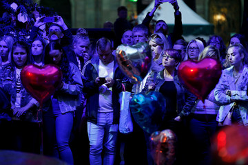 People gather during the first anniversary of the Manchester Arena bombing, in Manchester