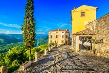 Motovun old town scenic. / Scenic view at medieval town Motovun in Croatia, city walls and promenade.