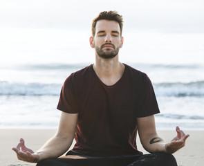 A man practicing yoga