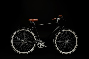 Photo on textile frame Bicycle side view of classic vintage bicycle isolated on black