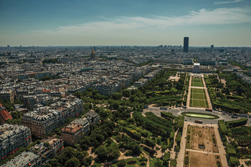 """Skyline, Champ de Mars Park and buildings under blue sky, seen from the Eiffel Tower in Paris. Known as the """"City of Light"""", is one of the most impressive world's cultural center. Northern France."""