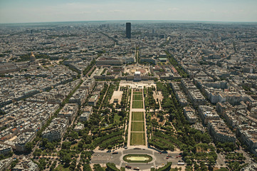"Skyline, Champ de Mars Park and buildings under blue sky, seen from the Eiffel Tower top in Paris. Known as the ""City of Light"", is one of the most impressive world's cultural center. Northern France."