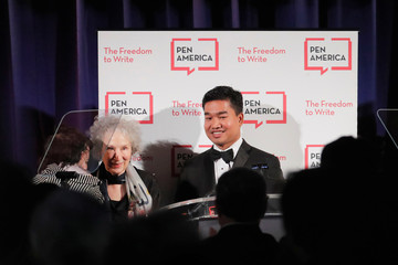 Author Margaret Atwood presents an award to Thura Aung (R) and Chit Su Win (L) on behalf of detained Reuters journalists Kyaw Soe Oo and Wa Lone at the PEN America Literary Gala in New York