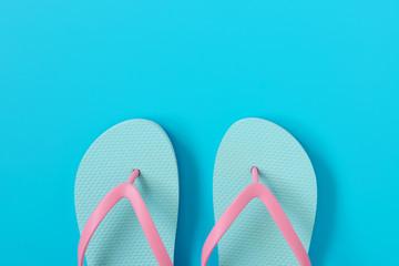 Flip-flops on blue background.