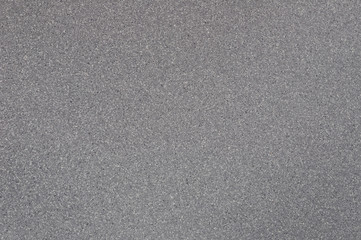 Background of gray granite with spotted texture.