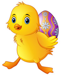 Cute little duck carrying a decorated egg