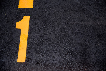 number 1 position paint on asphalt road background with copyspace