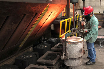 Worker prepares to pour molten iron into molds at Kirsh Foundry Inc. in Beaver Dam Wisconsin