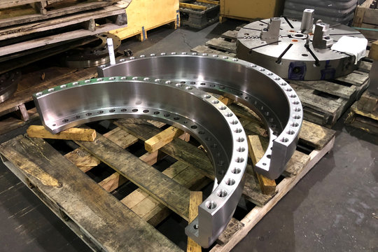 Large metal parts, destined to be use in industrial machines, are prepared for shipping at Wolfe and Swickard Machine Company Inc. in Indianapolis Indiana