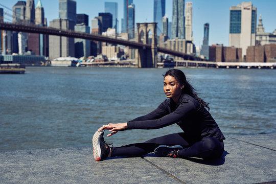 Pretty Black Woman Stretches Before Her Run