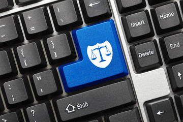 Conceptual keyboard - Blue key with shield and scales symbol