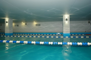 Swimming pool with blue water and the separation tracks for training children