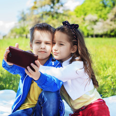 Little children do selfie. Square. The concept of childhood, family, friendship, lifestyle.