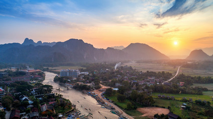 Aerial view of Vang vieng with mountains at sunset.