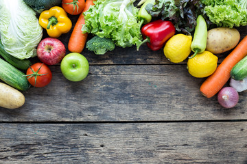 Top view of fruits and vegetables on the old wood table With copy space