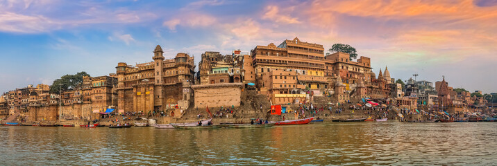 Varanasi India ancient city architecture panoramic view at sunset as seen from a boat on river Ganges. Fotomurales