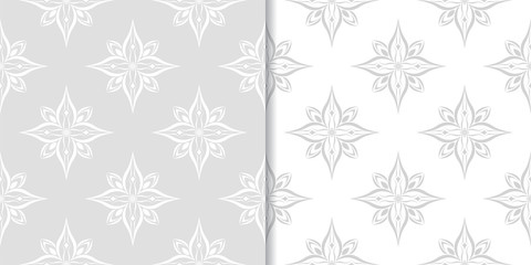 Light gray floral backgrounds. Set of seamless patterns