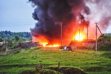 Fire, burning and concept of disaster - fire have approached constructions near the village
