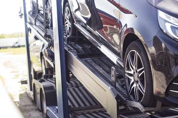 The truck transports premium-class cars, a