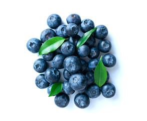 Blueberries with leaves isolated on white background. fresh bilberry closeup