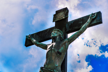 Crucifixion with Jesus against the sky with clouds - concept of faith