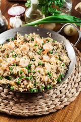 Fried rice with shrimp and vegetables on a frying pan