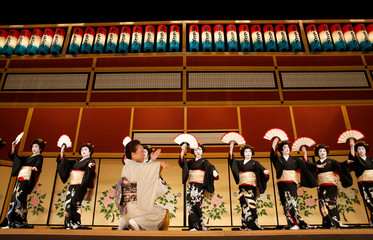 Geishas, traditional Japanese female entertainers, perform their dance review during a press preview of the annual Azuma Odori Dance Festival in Tokyo