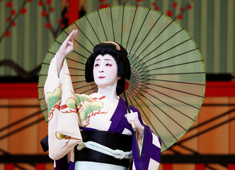 Geisha, a traditional Japanese female entertainer, performs a dance during a press preview of the annual Azuma Odori Dance Festival