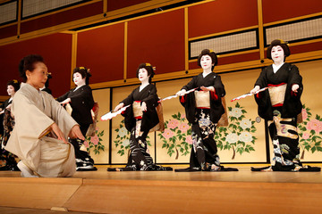 Geishas, traditional Japanese female entertainers, perform their dance during a press preview of the annual Azuma Odori Dance Festival in Tokyo