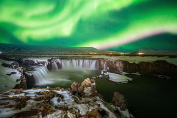 Northern light aurora at godafoss waterfall in iceland