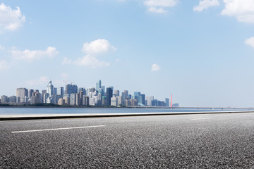 cityscape of modern city from empty asphalt road