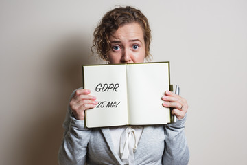 Nervous business woman handle note with GDPR (General Data Protection Regulation) act title