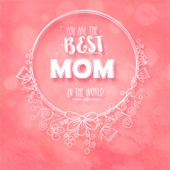 You are the Best Mom in the World text on floral decorated frame on pink background.