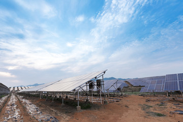 Large solar panels are being exposed to sunlight ,with blue sky