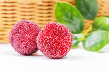 red and ripe waxberry under white background