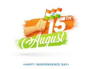 Human hand holding waving flag with text 15th August on saffron, green and white background.
