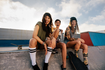 Group of female friends at skate park