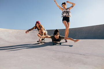 Group of women playing with skateboards