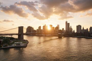 New-York skyline and Brooklyn bridge at sunset