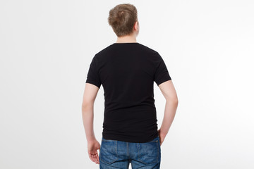 Young man wearing blank t-shirt isolated on white background. Copy space. Place for advertisement. Back shirt view