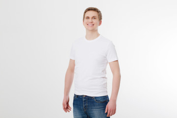 Front view. Young man wearing blank white t-shirt isolated on white background. Copy space. Place for advertisement